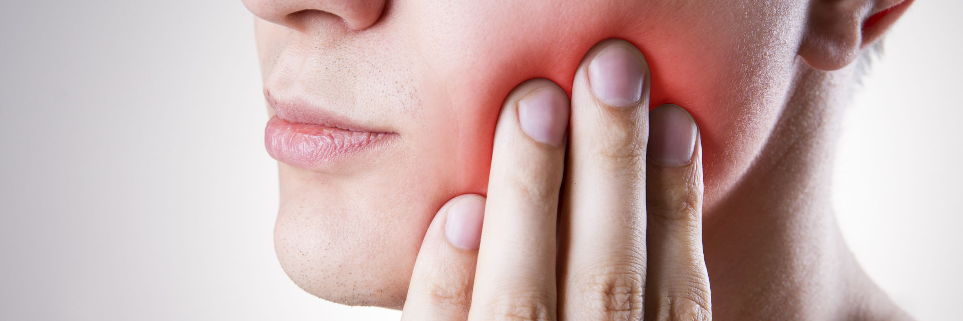 A person with dental pain caused by gum disease.
