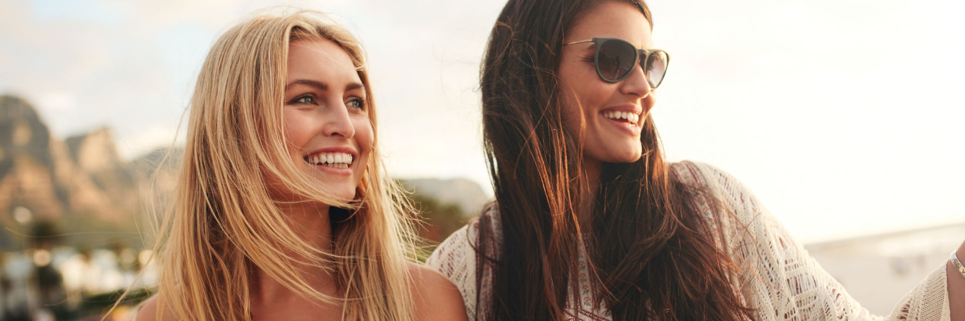 two attractive young women with perfect smiles