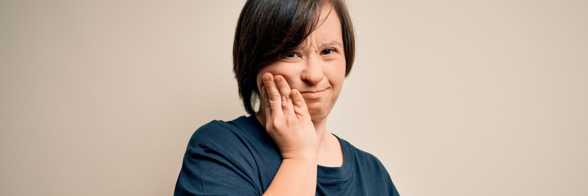 A woman with mental disability suffering from dental pain.