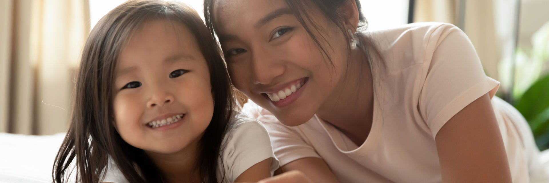 A happy Asian woman with her little daughter.